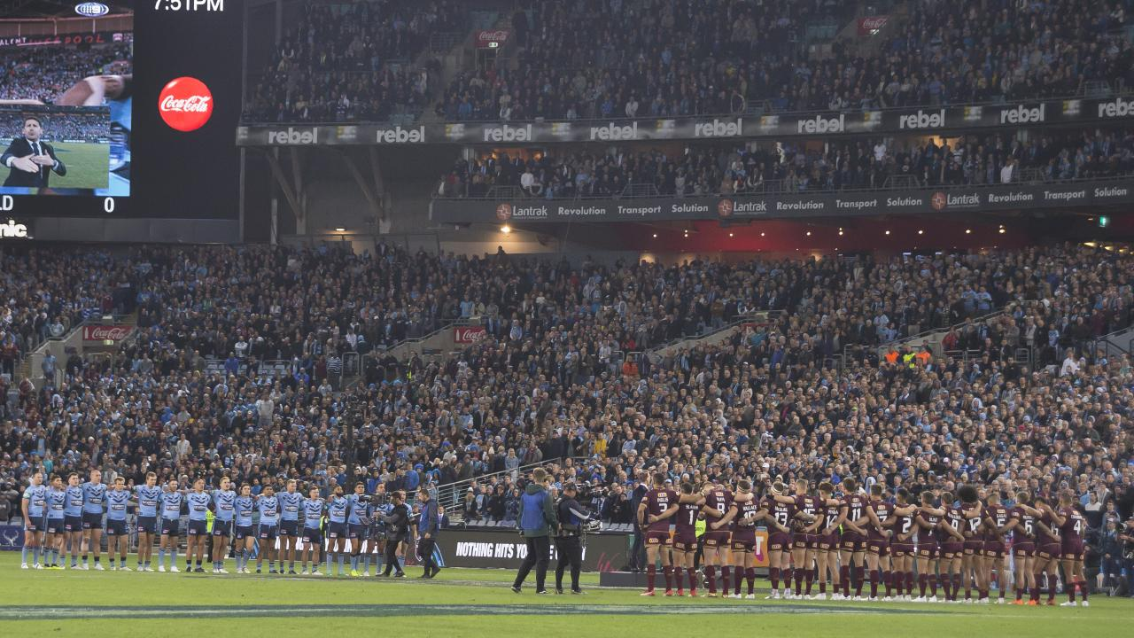 NSW and Queensland players line up for the national anthem before the start of Game Two during the 2018 State of Origin series. Picture: AAP
