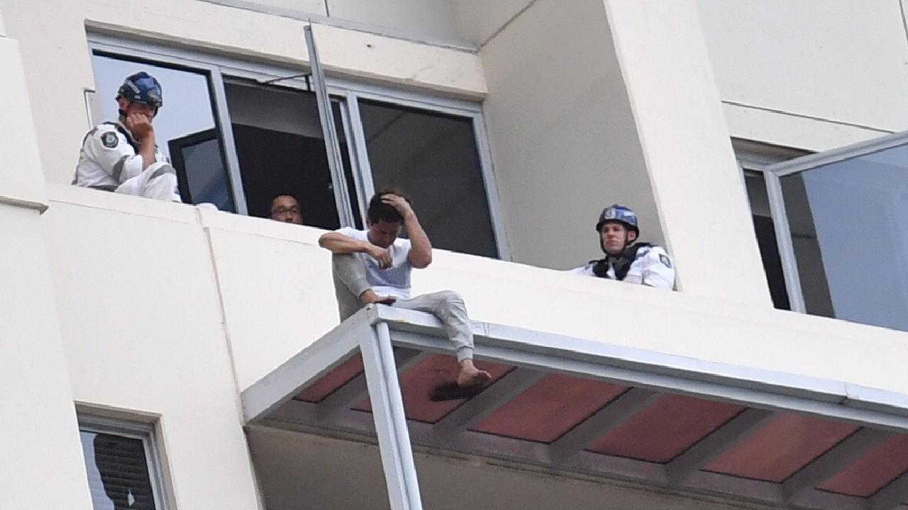 June Oh Seo on the ledge of the Chatswood apartment after pushing his girlfriend to her death. Picture: AAP Image/Mick Tsikas