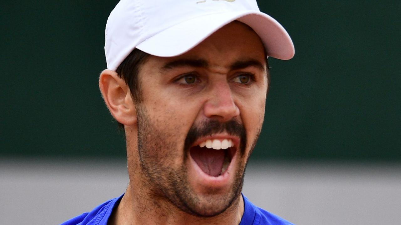 Australia's Jordan Thompson reacts as he plays against Croatia's Ivo Karlovic.