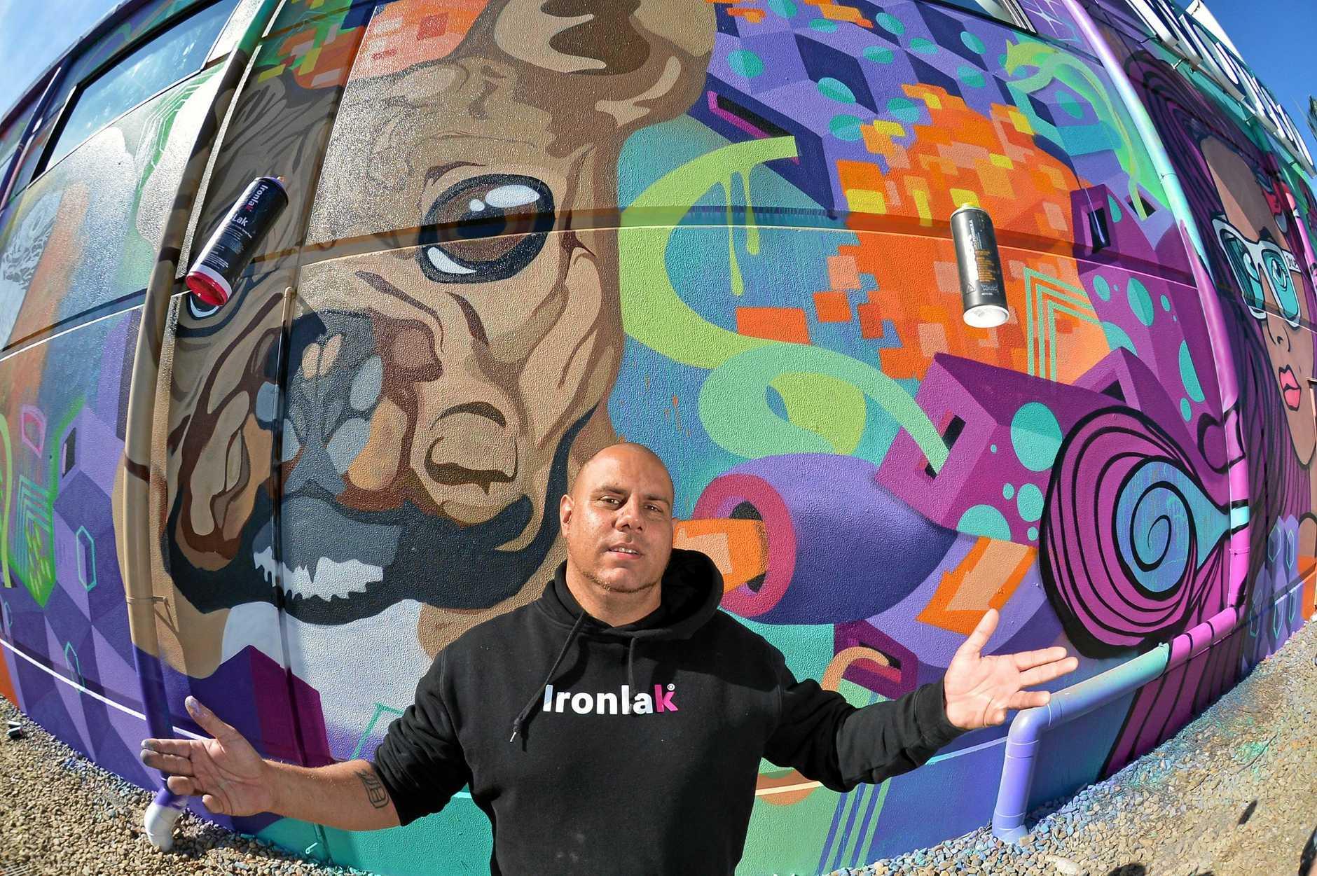 Mural atist Dan 'Dr Drule' Krause on his latest work at Wotso Workspace.