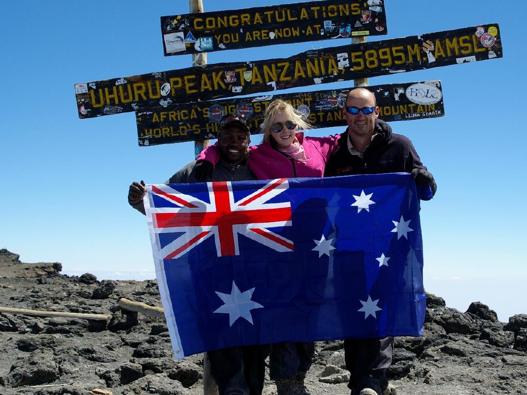 Alyssa Azar, her dad and their guide Godson on the summit of Mt Kilimanjaro.