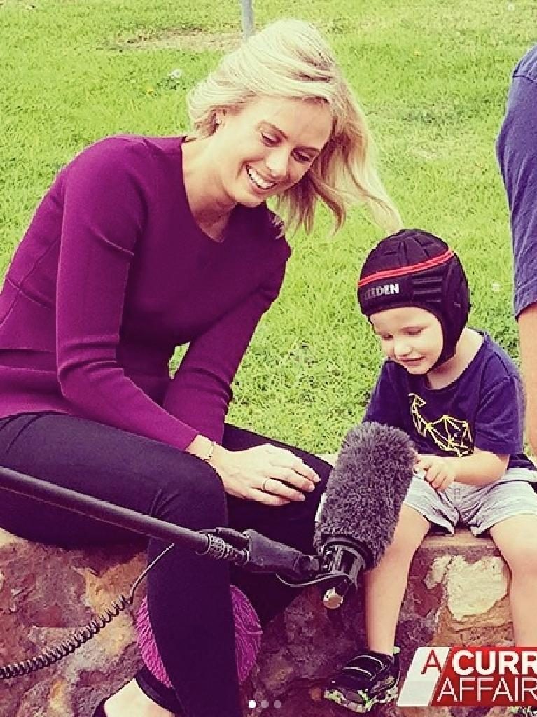 On A Current Affair last month with Kaiden Ryan, who has cerebral palsy and brain damage. (Picture: Channel Nine)