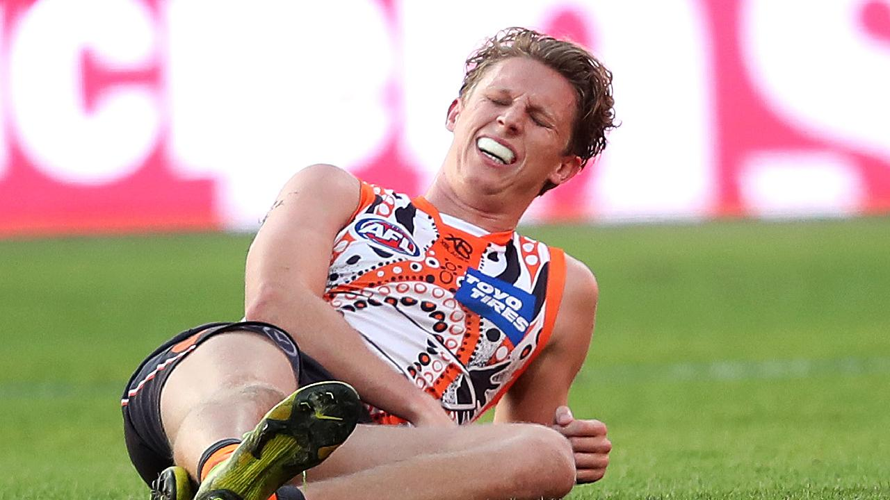 Lachie Whitfield was in agony after copping a hard hit against Gold Coast. Picture: Phil Hillyard.