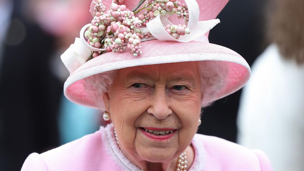 Queen Elizabeth II meets at the Royal Garden Party in Buckingham Palace, on May 29, 2019 where an influences broke protocol by handing her flowers. Picture: Yui Mok/AFP