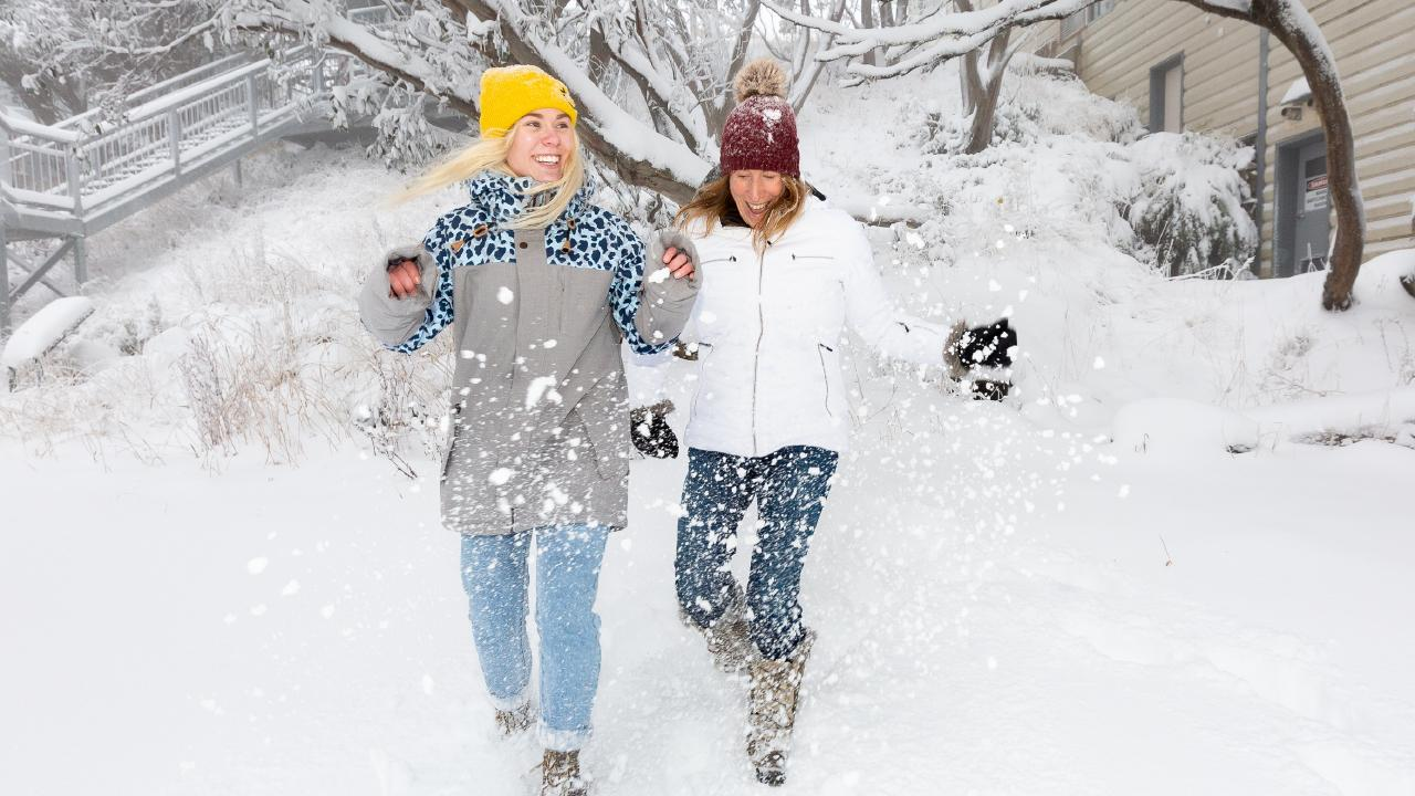 Jasmine Langworthy and Rhylla Morgan revel in fresh snow at Mt Buller last week. More snow is expected overnight and into Monday. Picture: Supplied