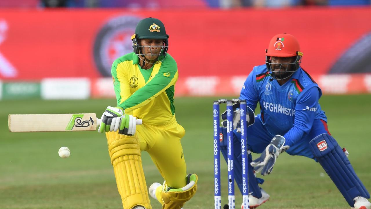 Australia's Usman Khawaja plays a shot during the