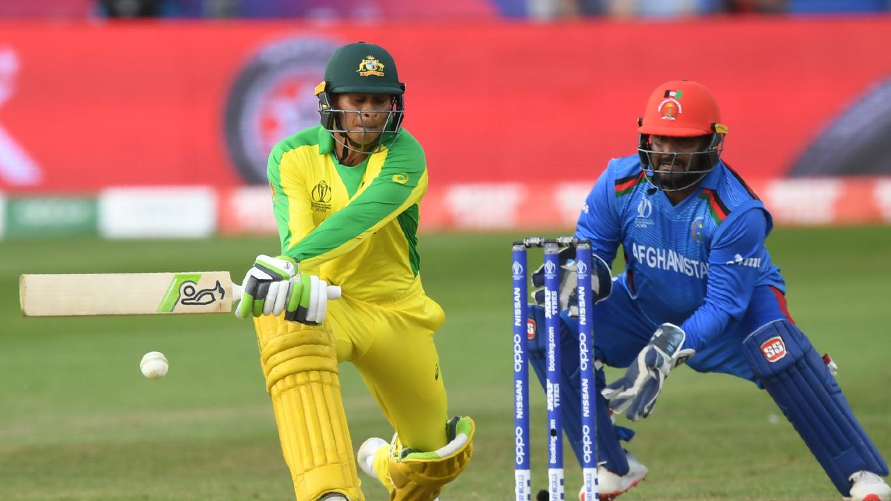 Australia's Usman Khawaja plays a shot during the
