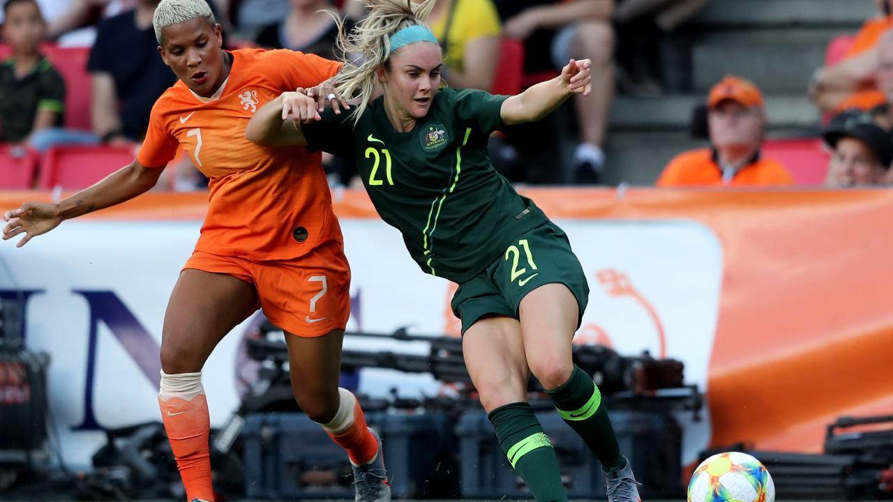 Australia's Ellie Carpenter (R) challenges Shanice van de Sanden of the Netherlands for the ball. Picture: Getty