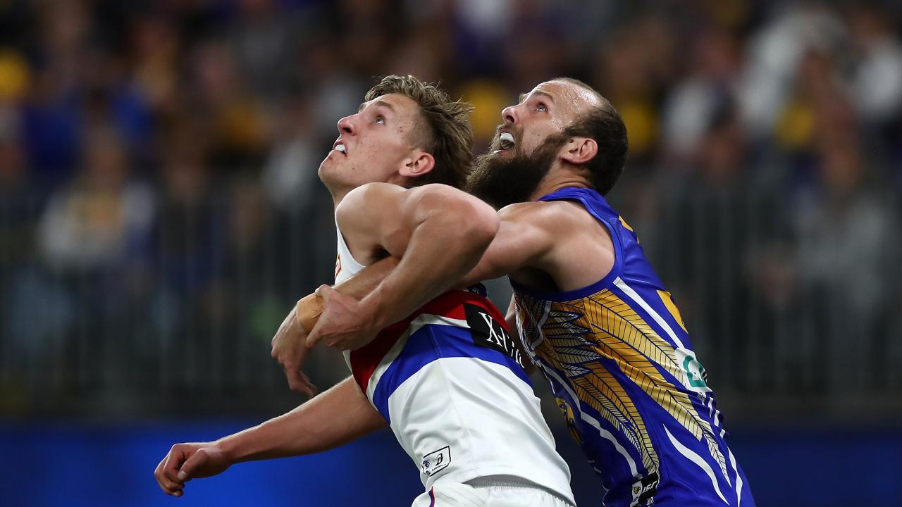 Aaron Naughton battles Eagles rival Will Schofield for the ball. (AAP Image/Gary Day)