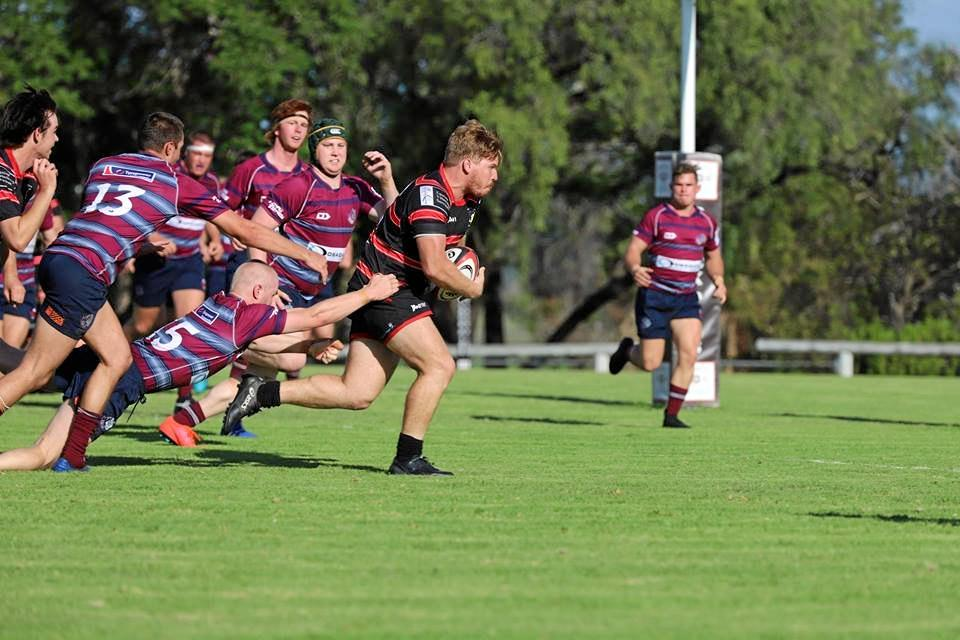 PUSHING HARD: Dean Bichel makes a run for the Gatton Blackpigs against the Toowoomba Bears. The Pigs put up a strong fight but went down 24-12 on the weekend.