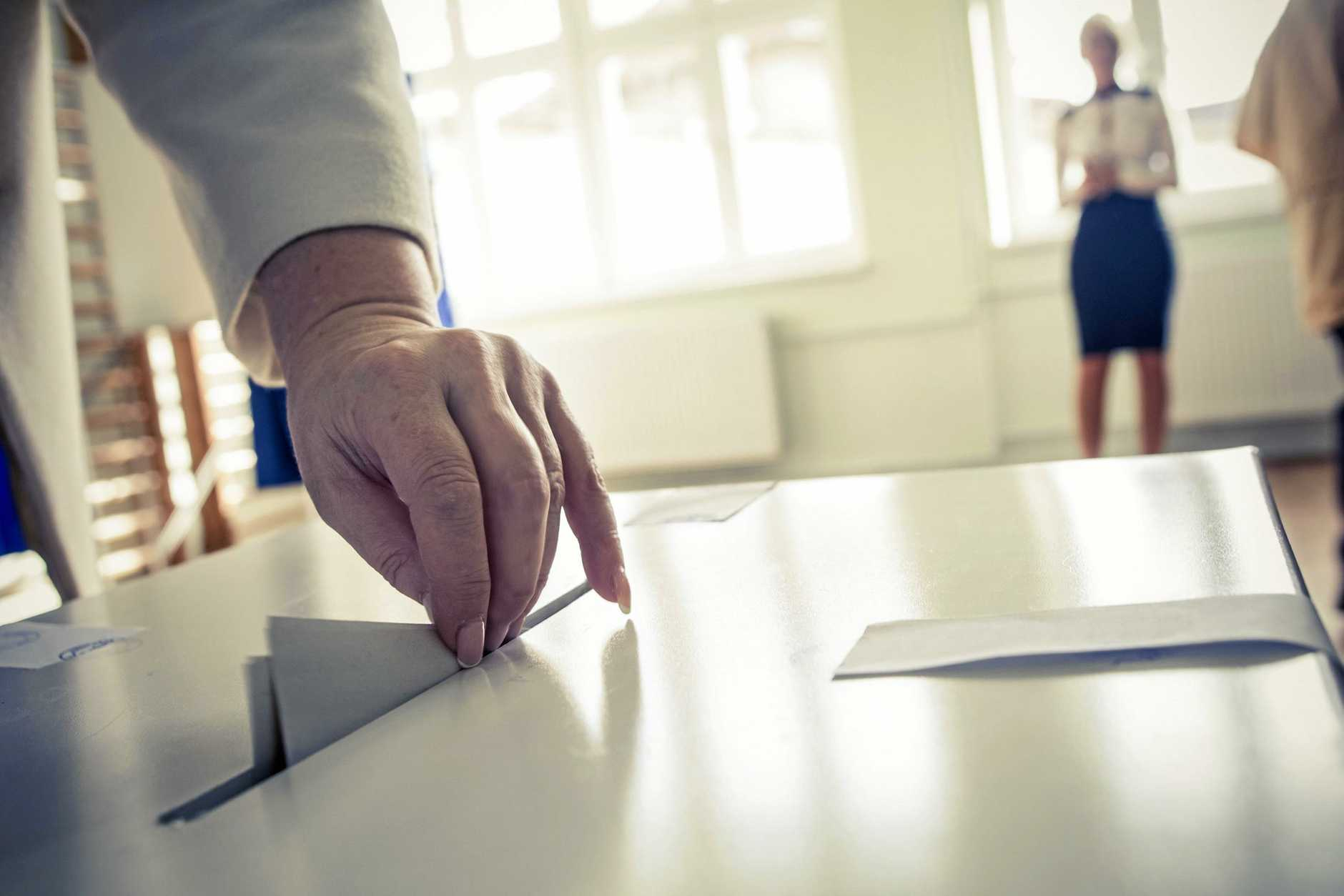 Casting a ballot at a polling station.
