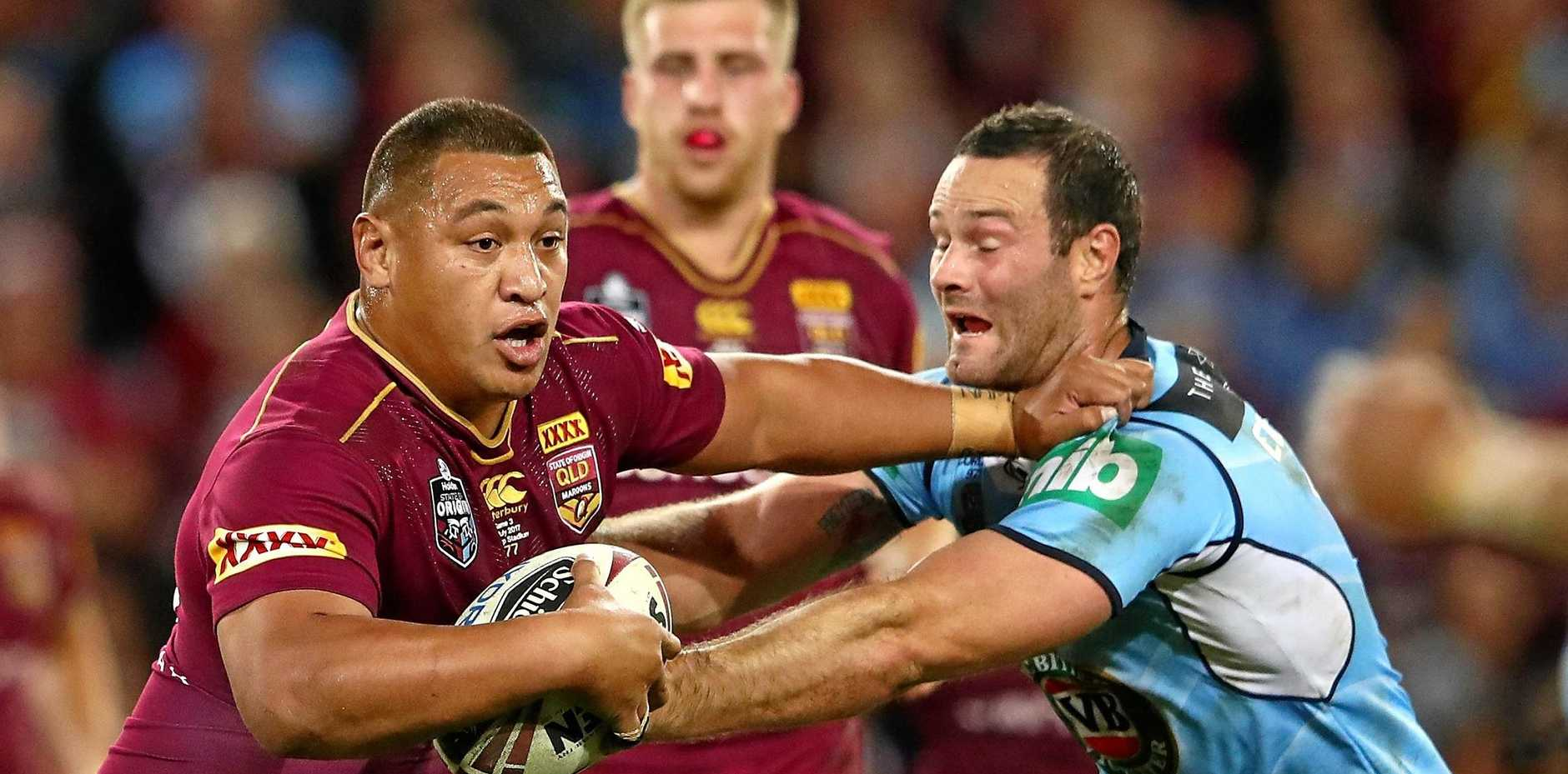 Joshua Papalii of the Maroons is tackled during game three of the State Of Origin series between the Queensland Maroons and the New South Wales Blues at Suncorp Stadium on July 12, 2017 in Brisbane, Australia.