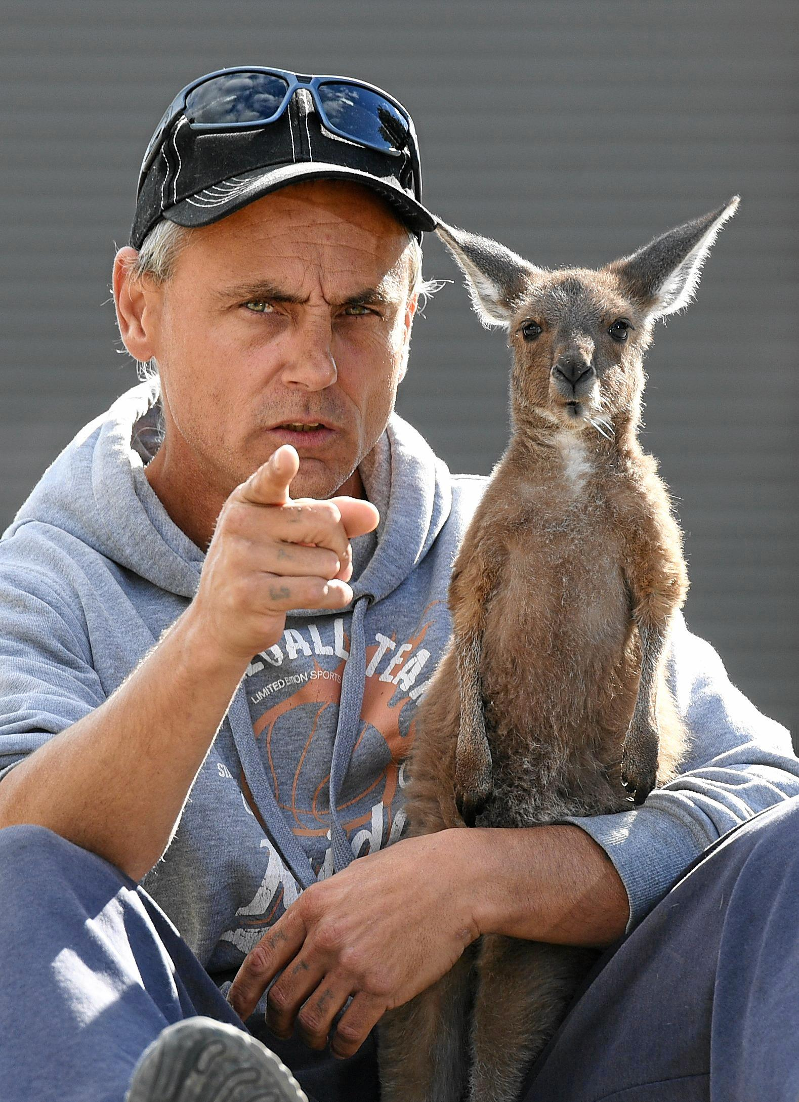 Wildlife carer Danny Williams and his kangaroo Esperance