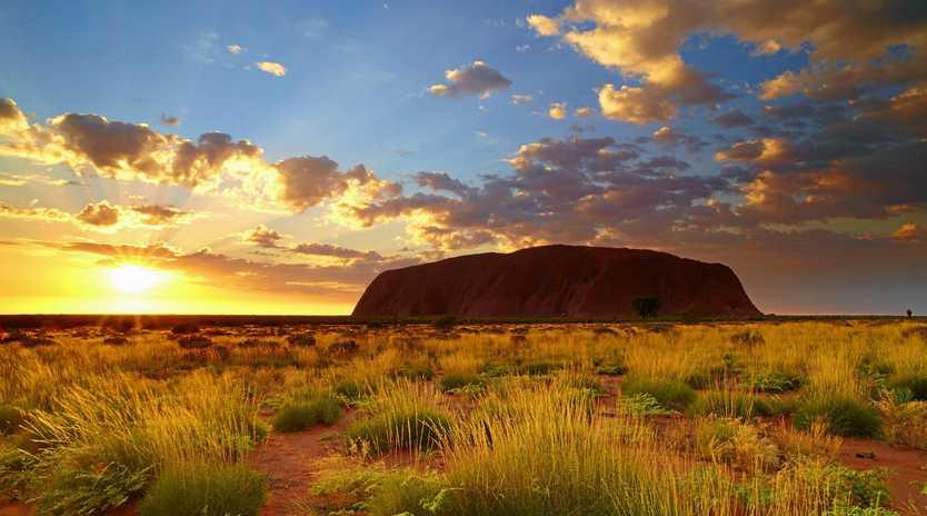 Columnist Nick Bennett met his partner and wife at sunrise on top of Uluru.