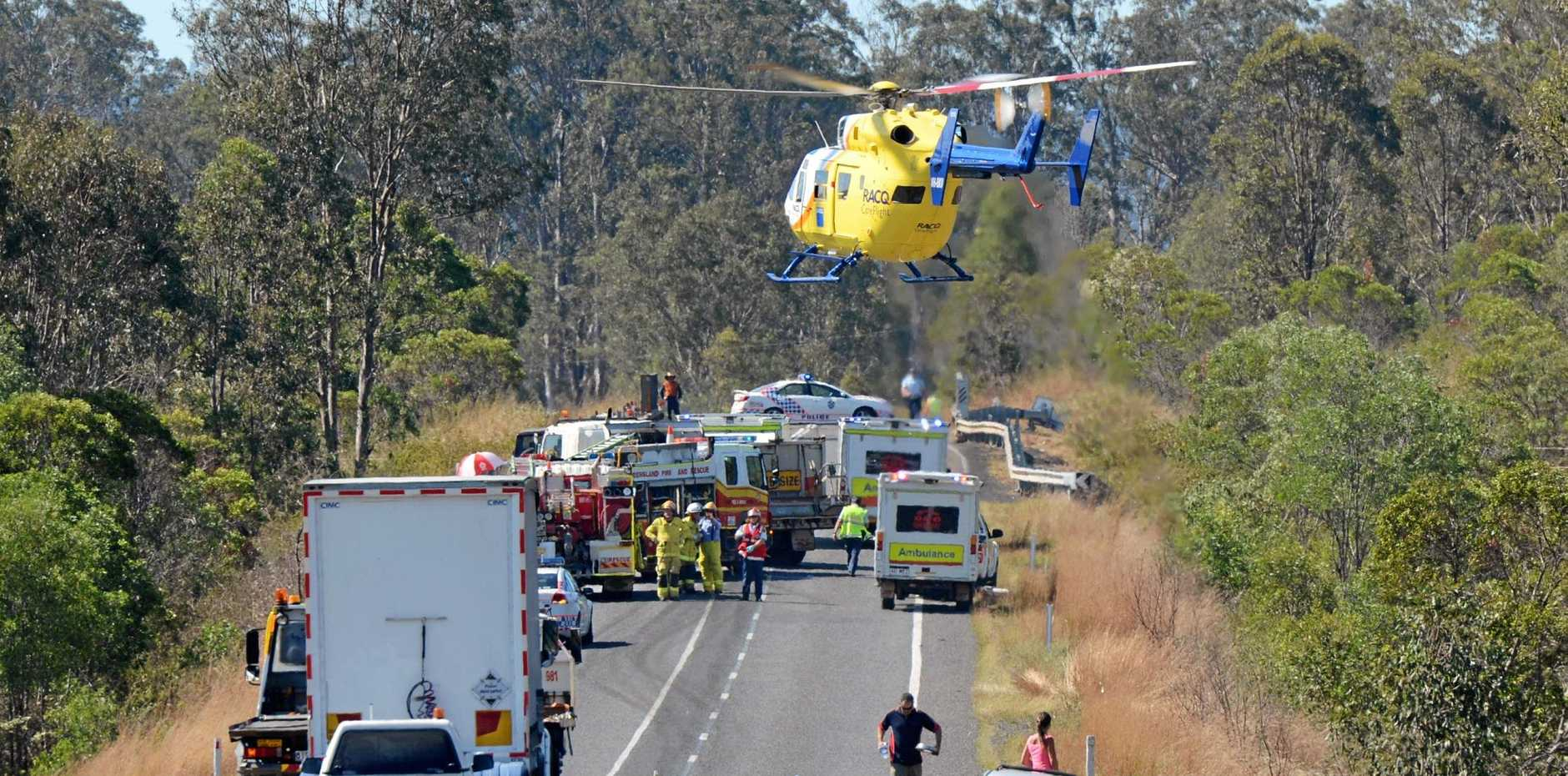 CHOPPER RESCUE: The RACQ rescue helicopter lands on the Bruce Hwy at Curra to help tend to the injured after a two car crash.  Photo Craig Warhurst / The Gympie Times