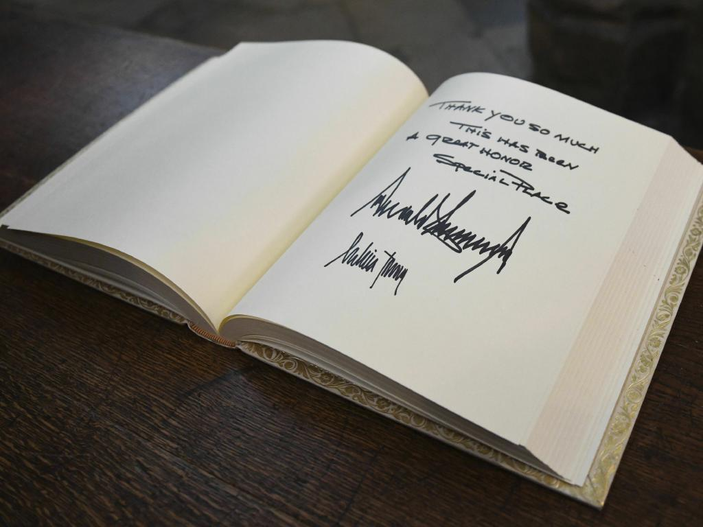 The Trumps signed the visitors book at Westminster Abbey. Picture: AP