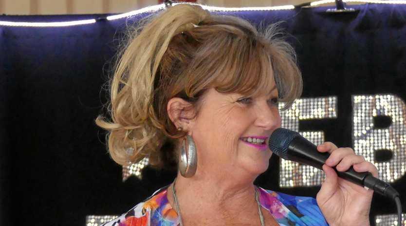 MUSICAL MEMORIES: Singer Debbie Robertson brings Golden Hits Of Yesterday to   Pelican Waters Bowls Club.
