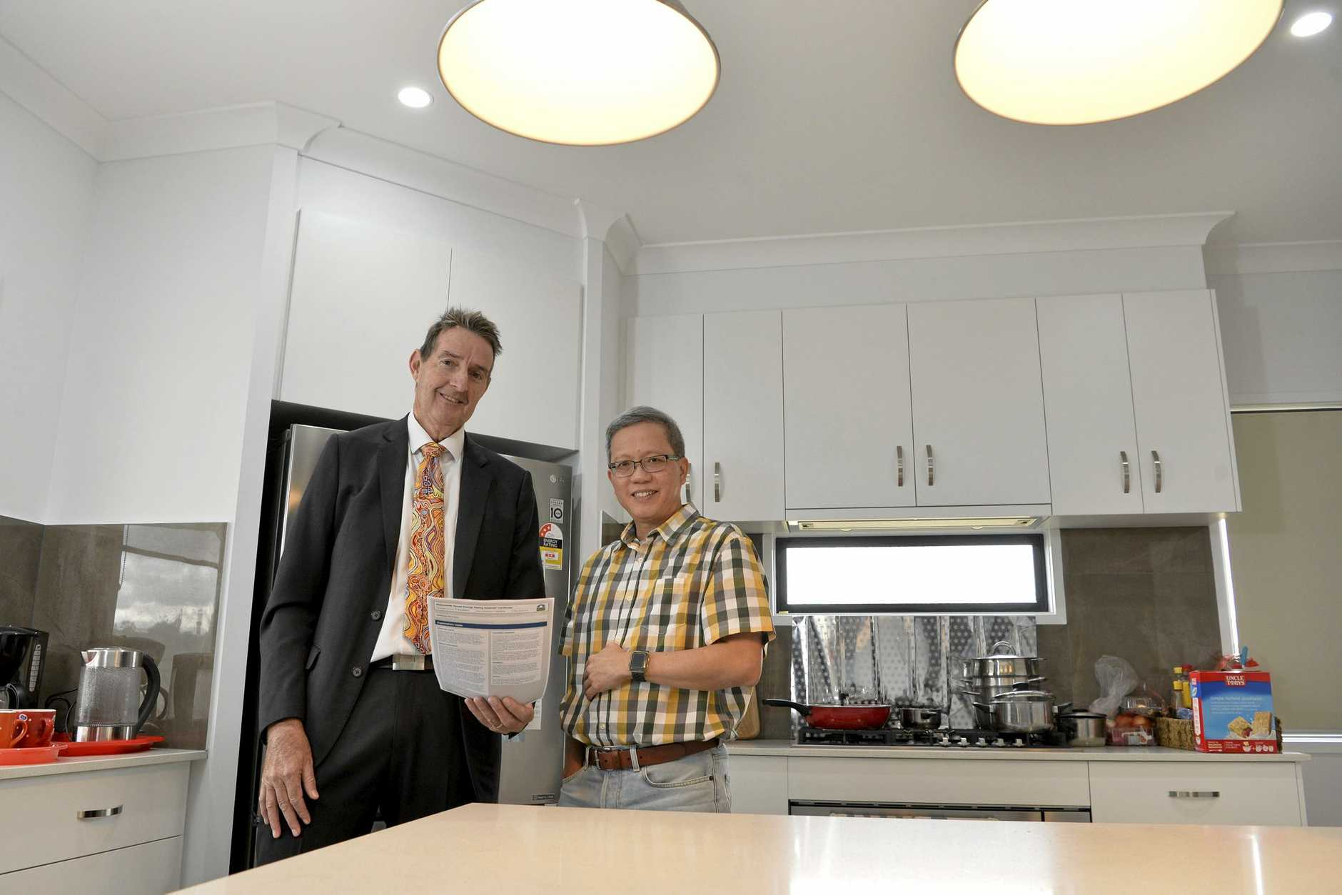Wee Wong (right) in his Geoff Gibson Home built family home, with Geoff Gibson, that has half the energy needs of a standard Toowoomba home, Tuesday, June 4, 2019.