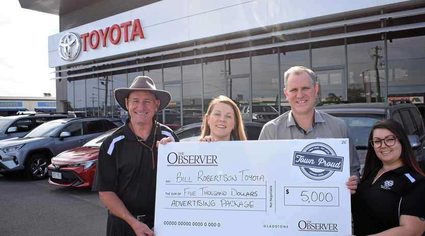 WINNING EDGE: Erin and James Robertson (centre) from Bill Robertson Toyota are joined by acting mayor Chris Trevor and The Observer's Teeanna Thomsen to accept the cheque for winning the Town Proud advertising package.