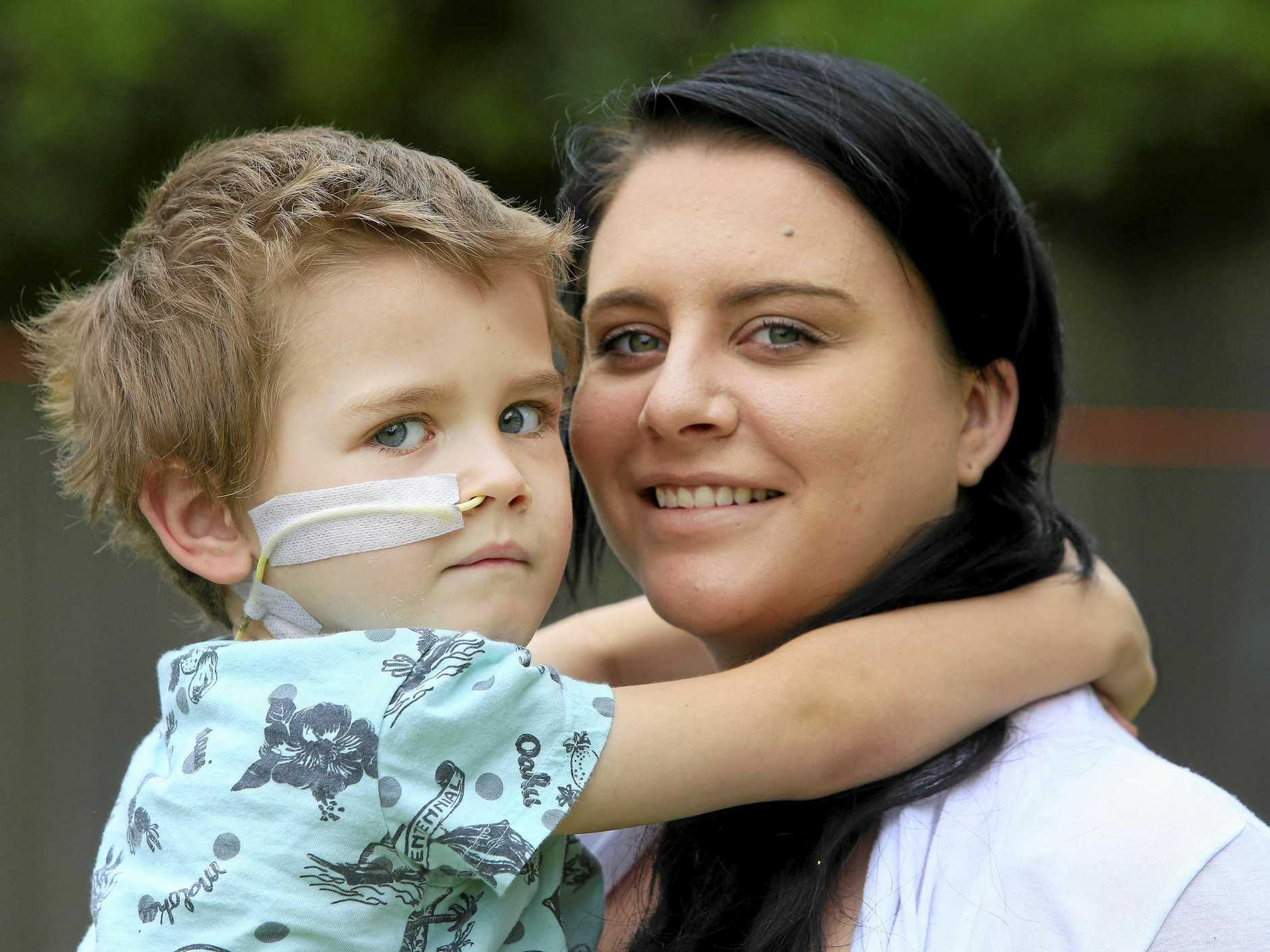 Story about Miller O'Flynn, 6, a gorgeous little boy whose body is degenerating from a rare disease similar to Parkinsons. No doctor can tell him how long he will live, or what effect the disease will have.  With his mother Sophie Cashen. Pic Megan Slade