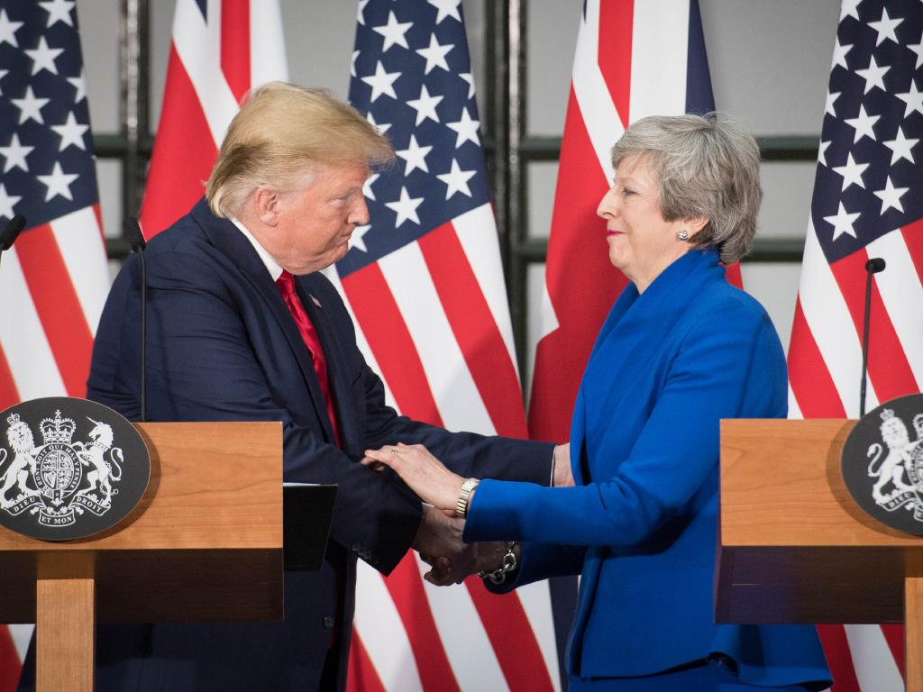 Finally. Trump makes a point of shaking Theresa May's hand after being criticised for not doing so earlier in the day. Picture: Stefan Rousseau — WPA Pool /Getty Images.