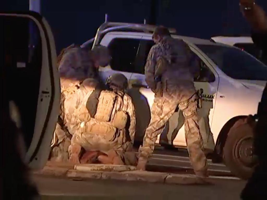 Members of the Territory Response Group (TRG) arrest a suspected gunman in Darwin. Picture: AAP Image/Supplied by ABC News