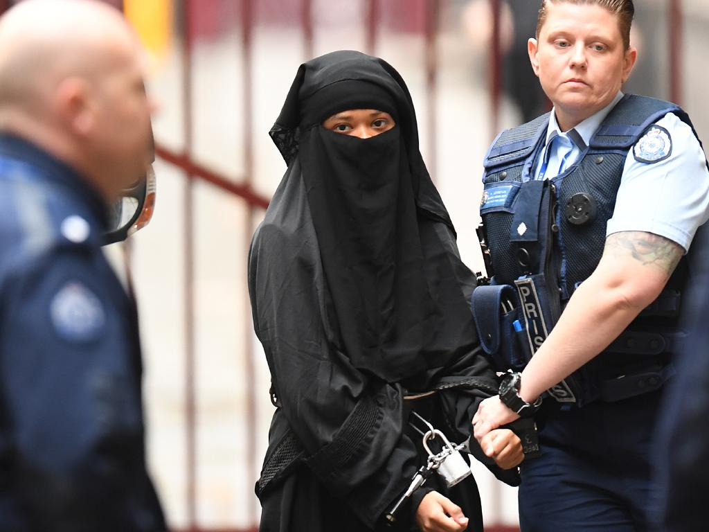 Handcuffed and shackled, Momena Shoma arrives at the Supreme Court in Melbourne to be sentenced for violent jihad. Picture: Erik Anderson.