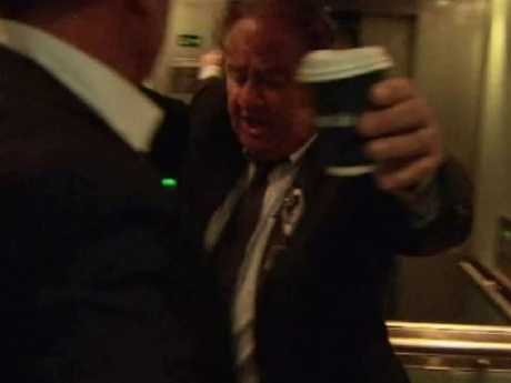 Mr Gertos appears to pour coffee over a Channel 9 reporter. Picture: A Current Affair/Nine