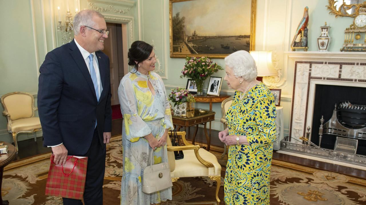 Scott and Jenny Morrison had a very special gift for the Queen when they met the monarch at Buckingham Palace. Picture: AP