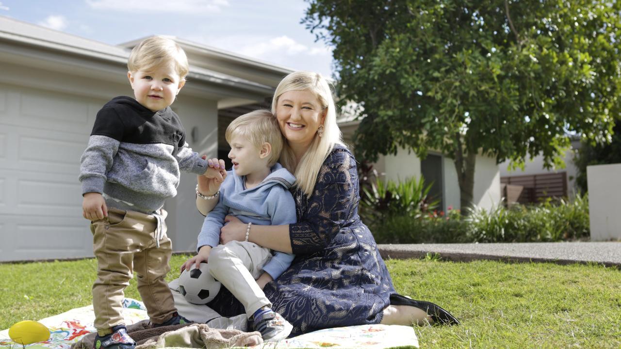 Brisbane homeowner Rachael Tickner and her sons Oscar, 18 months and Ollie, 3. Photo: AAP/Megan Slade.