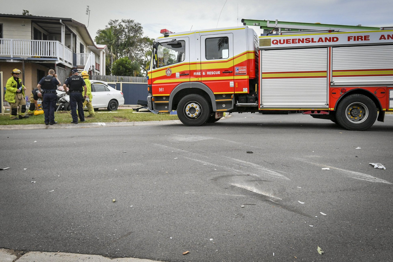 A woman in her 70s was transported to Gladstone Hospital after being trapped in her vehicle after it rolled on Malpas Street and damaged a fence.