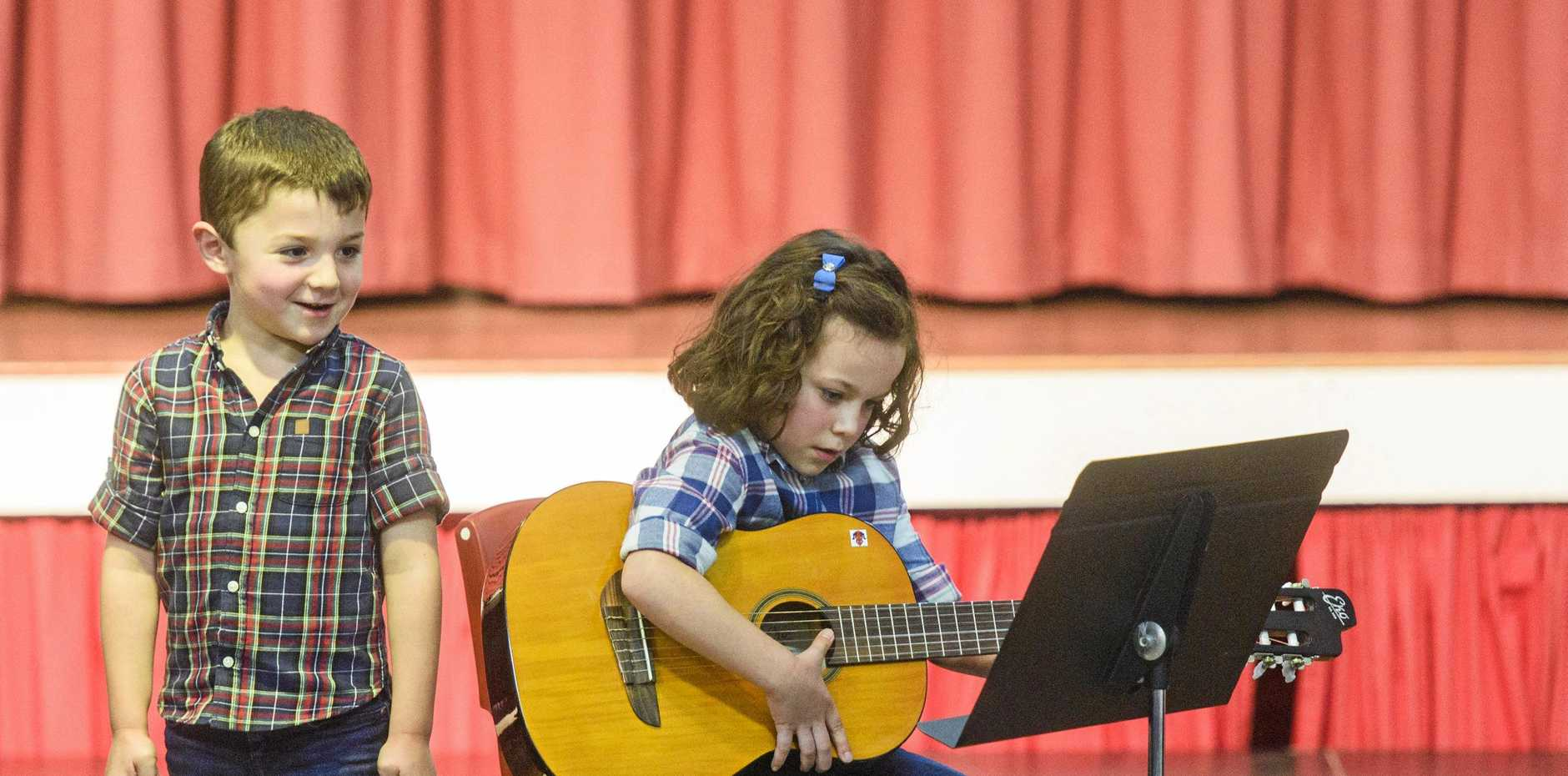 ENTERTAINERS: Stanley and Elena Robertson play in the family section of the Lower Clarence Music Eisteddfod.
