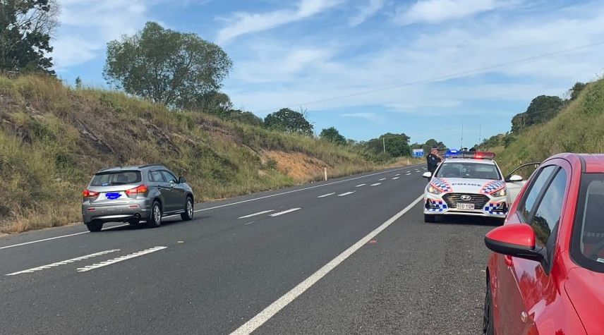 A man is believed to still be on the run after an incident earlier this morning prompting the closure of the Bruce Highway for over an hour. This photo was taken from Bauple-Woolooga Road where it all took place. Credit to Nine News.