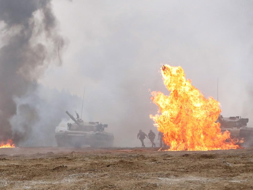Chinese troops and tanks engage in a recent large-scale combat exercise. Picture: ChinaMilitary