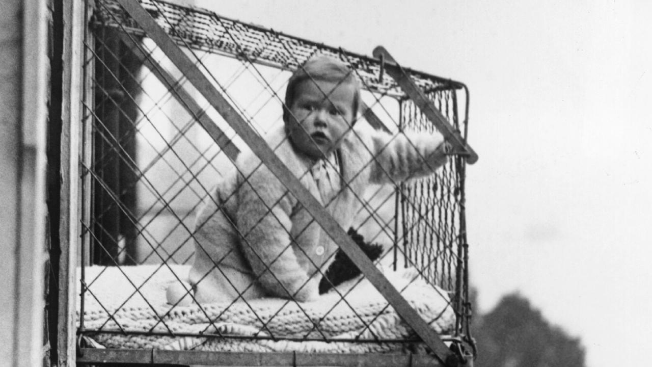 A wire baby cage in use in London in 1934. Picture: Fox Photos/Getty Images