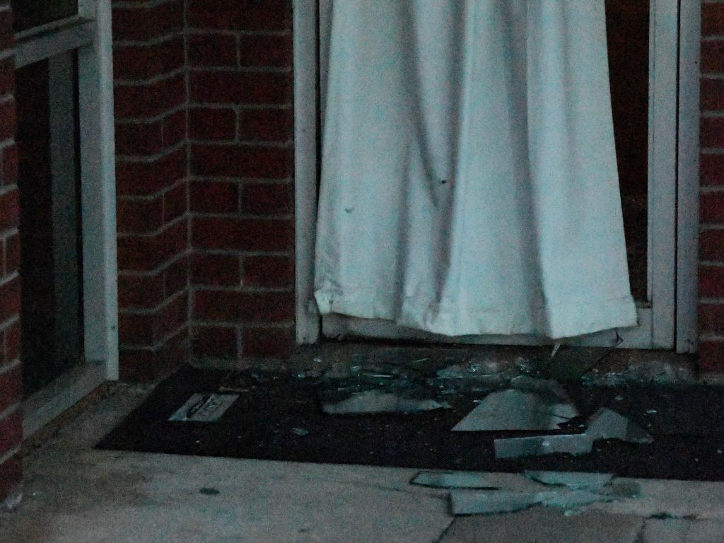 Broken glass is seen at the front of the Palms Motel. Picture: Keri Megelus