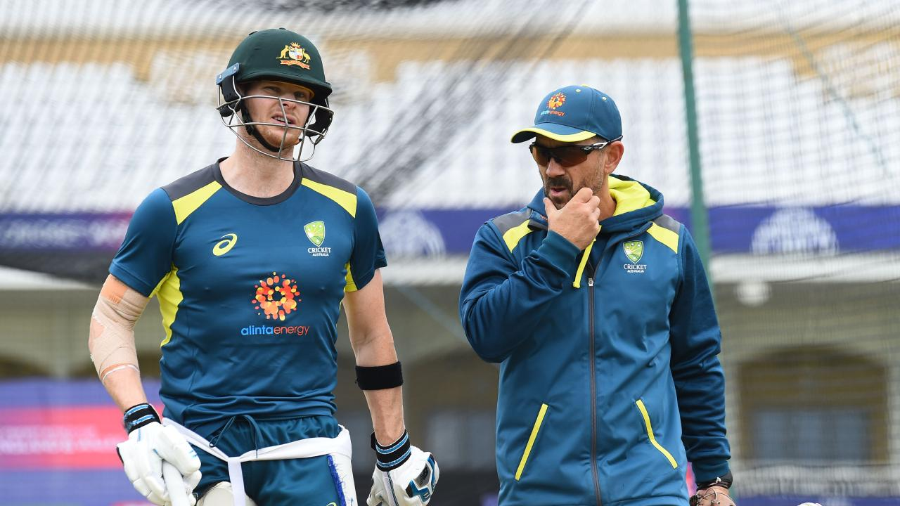 Justin Langer and Steve Smith talk tactics during a nets session. (Photo by Nathan Stirk/Getty Images)