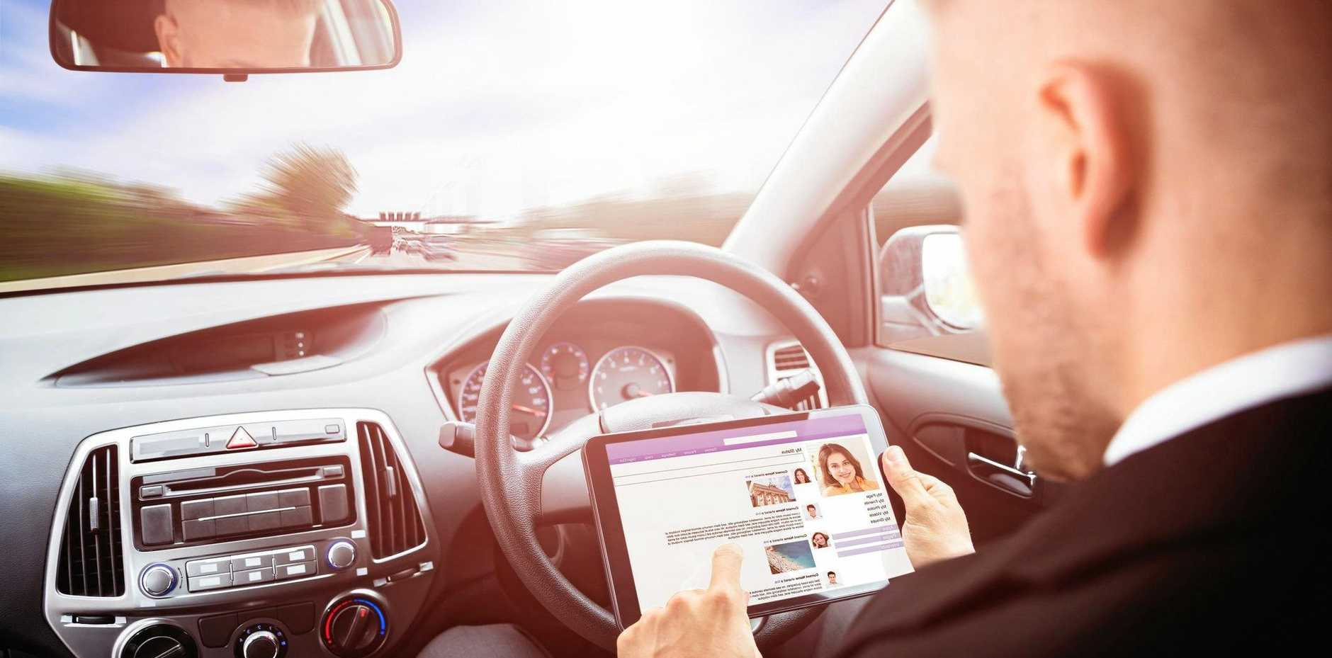 ABOVE: A businessman chats on social media while a driverless car takes care of the rest.
