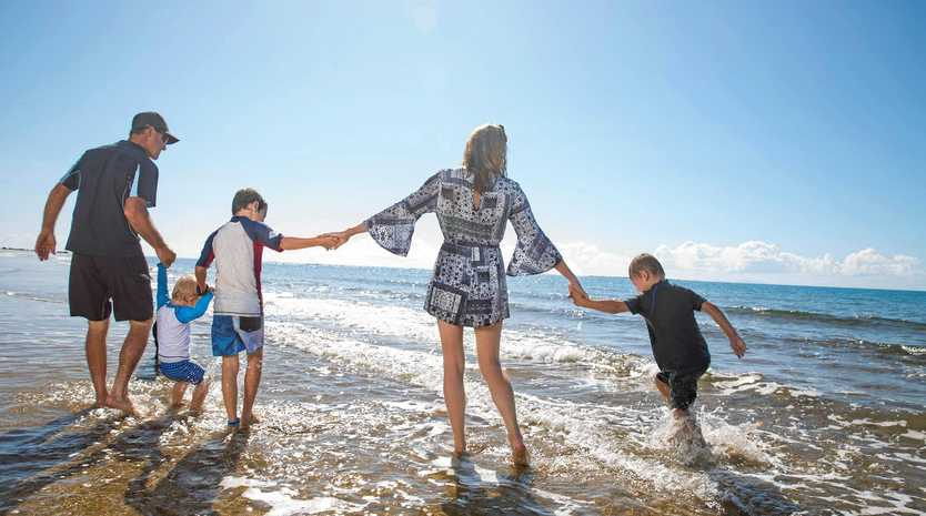 LIFESTYLE: Sarina Beach Motel owners Darren and Meaghan Thompson, with children Jimmy, Rylee, and Declan love that the motel allows them to live so close to the beach.