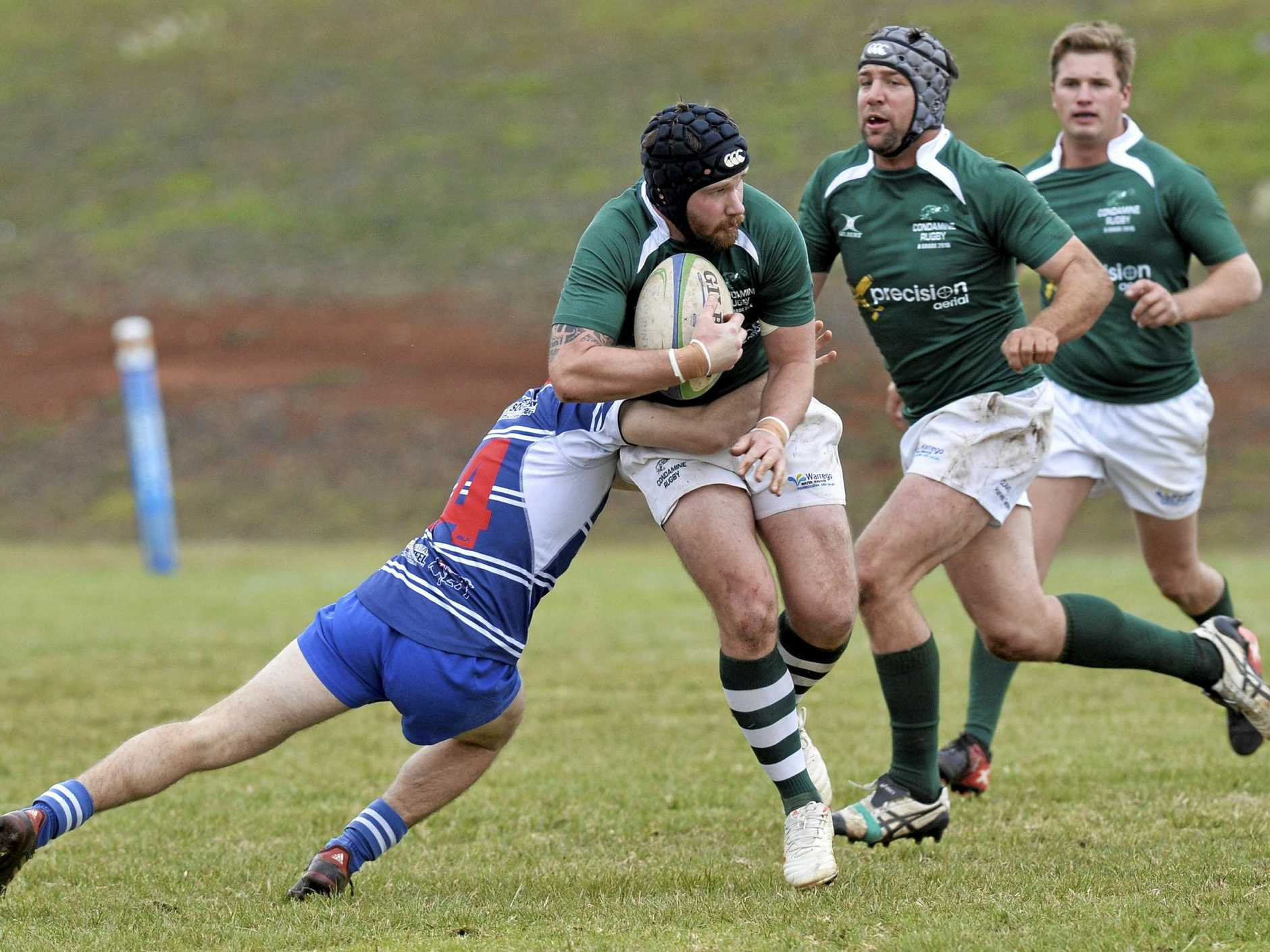 Condamine's Kim McGregor is caught by a USQ defender during last week's round-10 Risdon Cup match at USQ Oval.