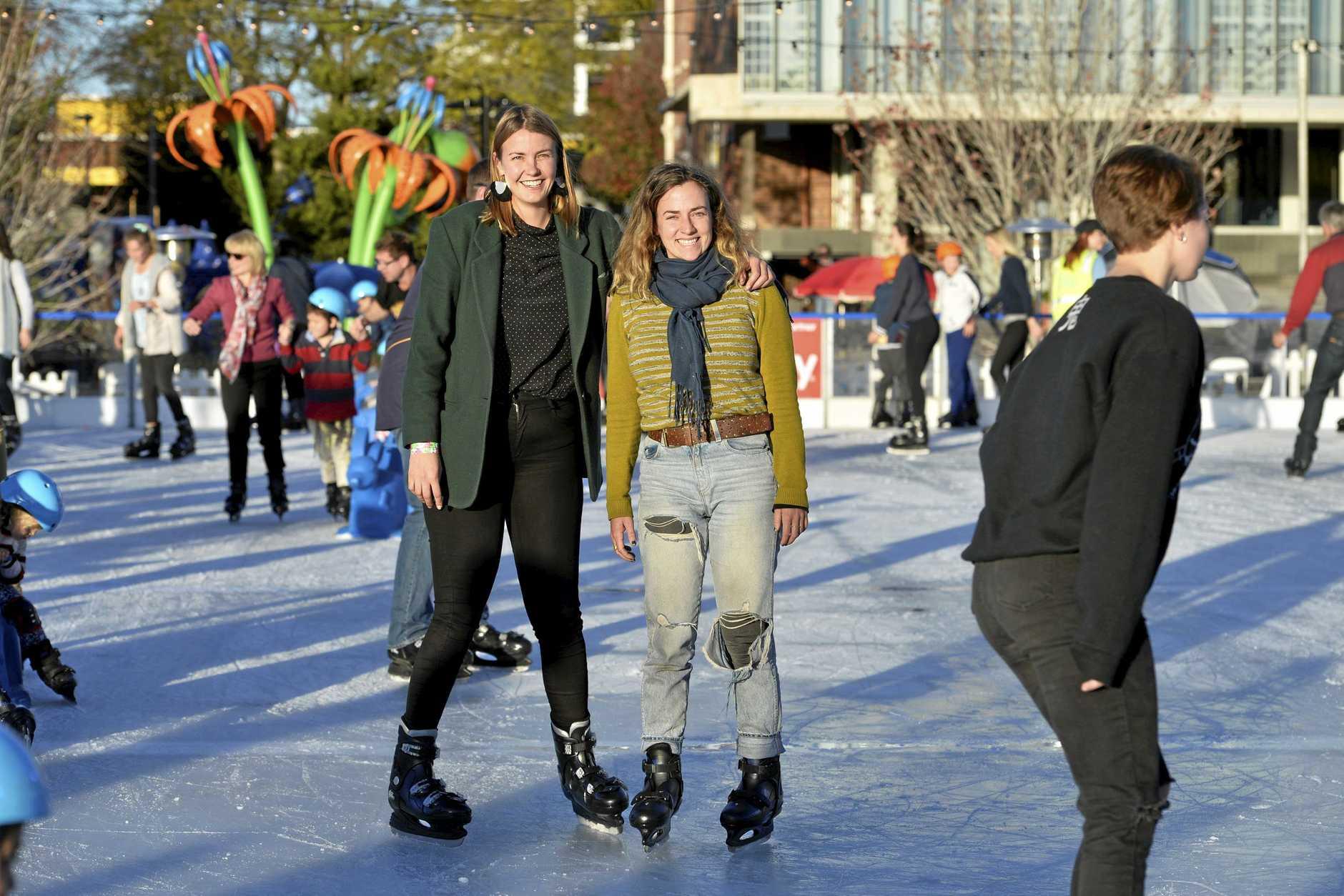 Grace Dewar (left) and Bronte Naylor ice skating at Winter Wonderland in the Civic Square, Friday, June 22, 2018.