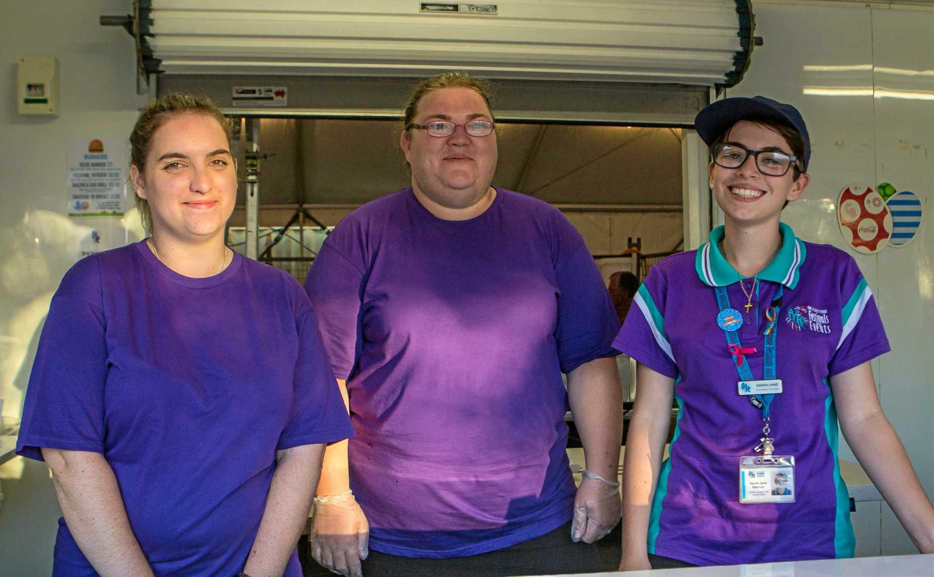 VOLUNTEERS: Kristen Murkett, Rebecca Murphy and committee member Sarah-Jane Kiernan at the 2019 Harbour Festival.