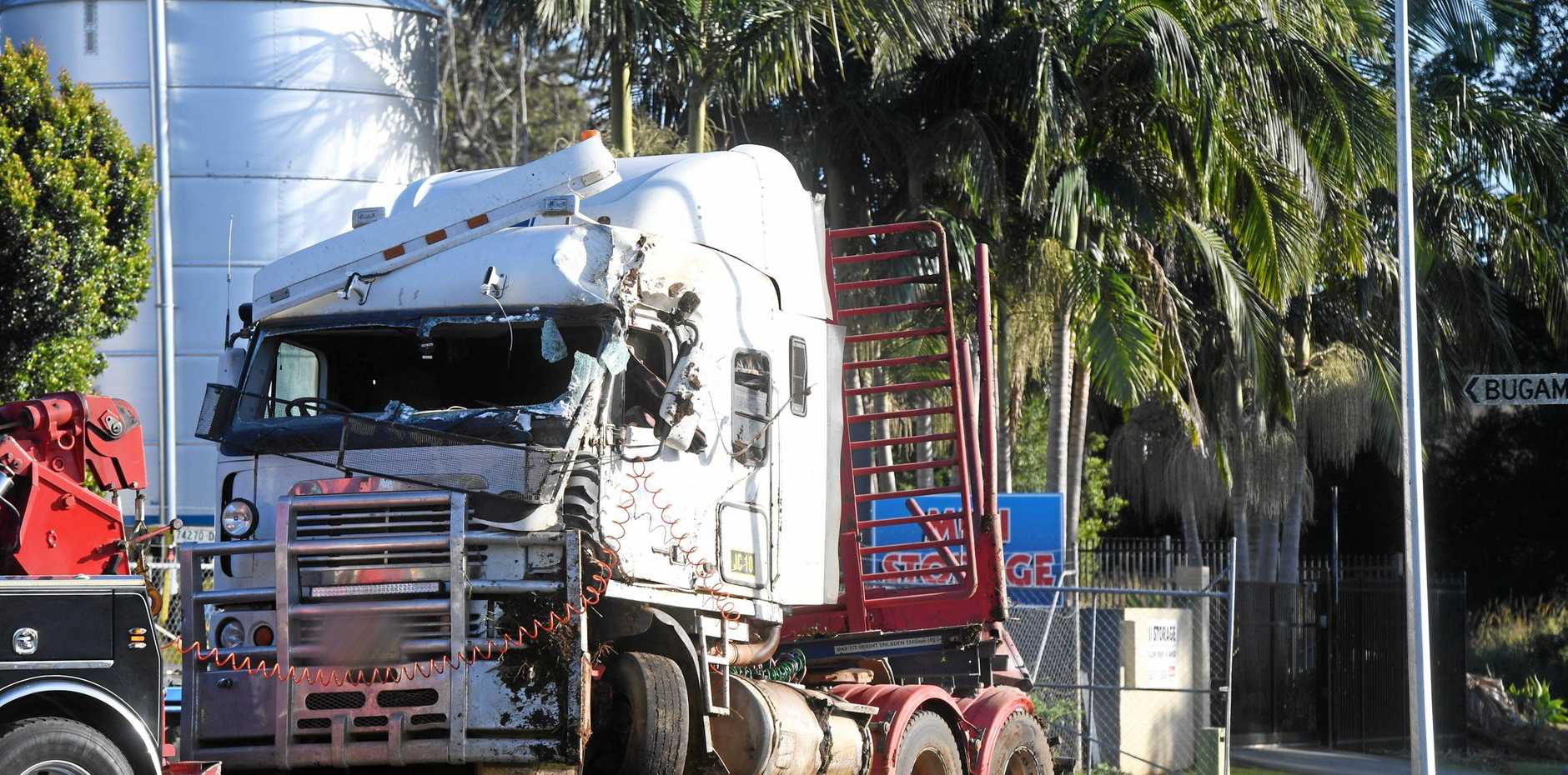 A TRUCK driver has died after his semi-trailer rolled on the Lismore-Bangalow Rd at Binna Burra last night.