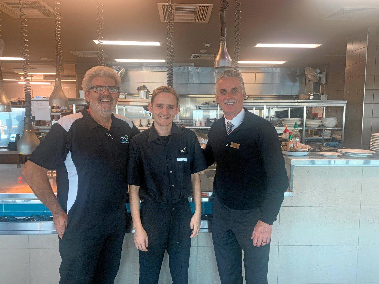 HARDWORK PAYS OFF: Harry is enjoying his new role at Ballina RSL. (L-R) Petar Ilic (ON-Q), Harry Eggins and Bill Coultier, CEO, Ballina RSL.