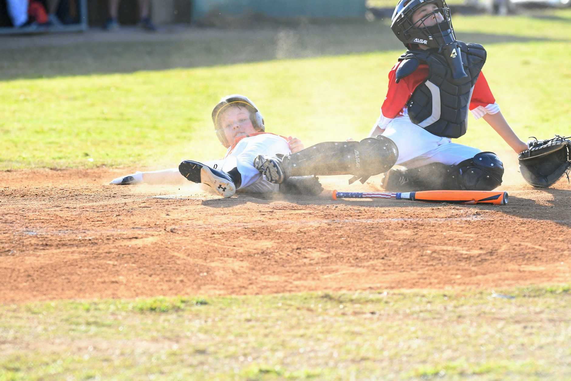 Canberra player Harry Austin slides in during the game against Northern Metros at the Australian Little League Baseball Championship.