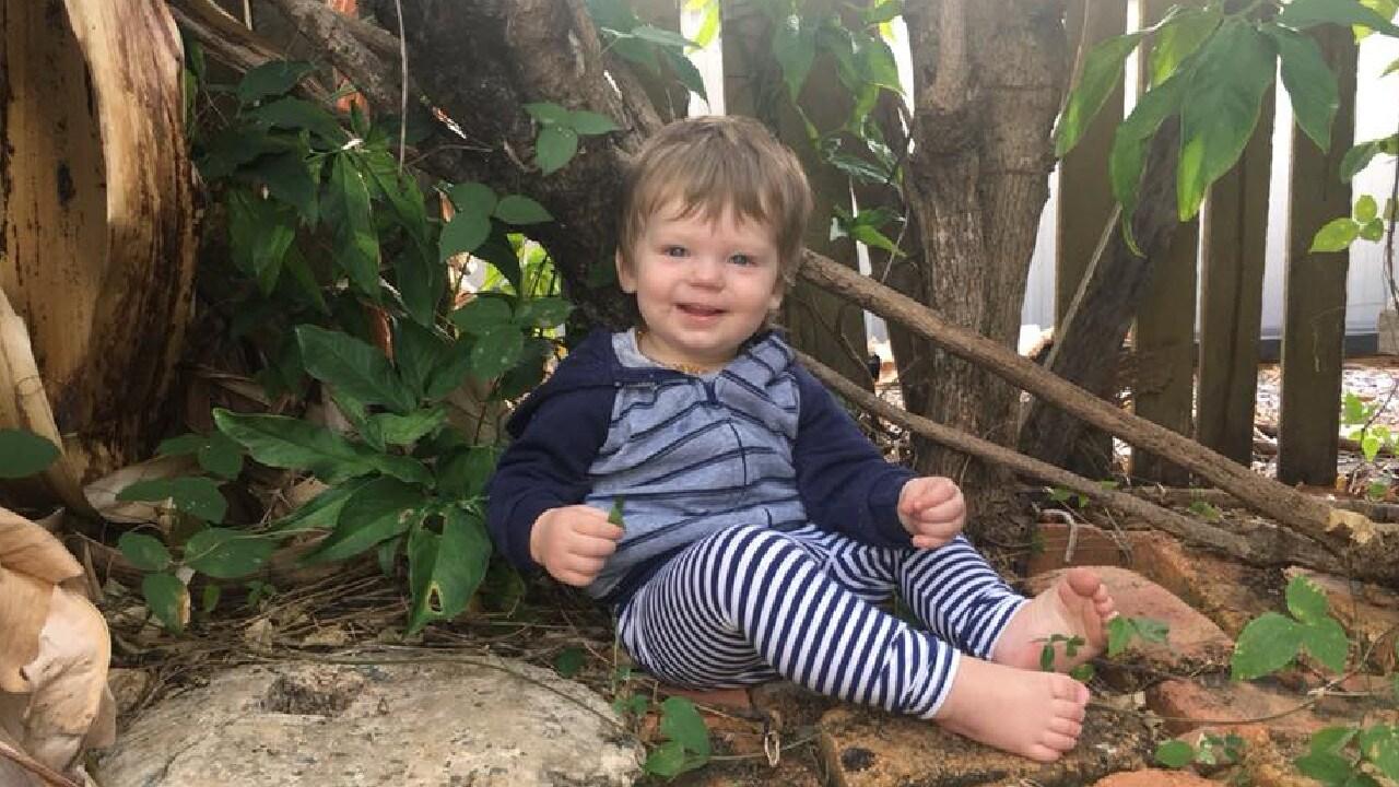 Toddler Ruben Scott, 2, who has gone missing at Koolatah Station, with mum Natasha Scott.