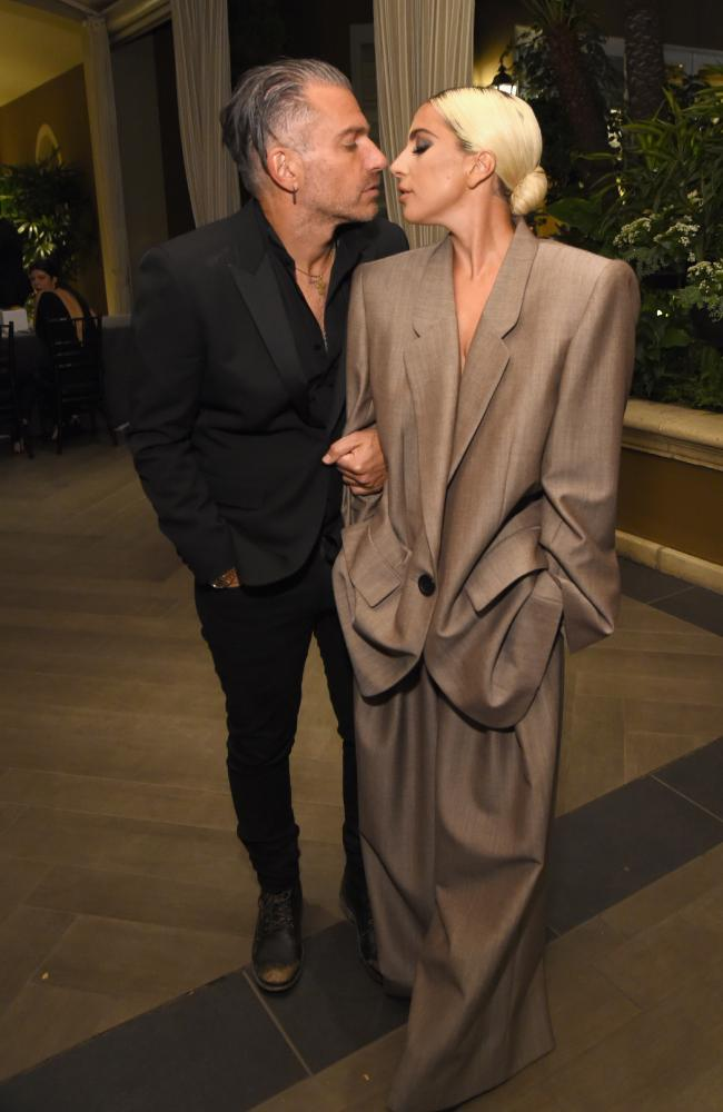Christian Carino and Lady Gaga attend ELLE's 25th Annual Women In Hollywood Celebration last year. Picture: Getty