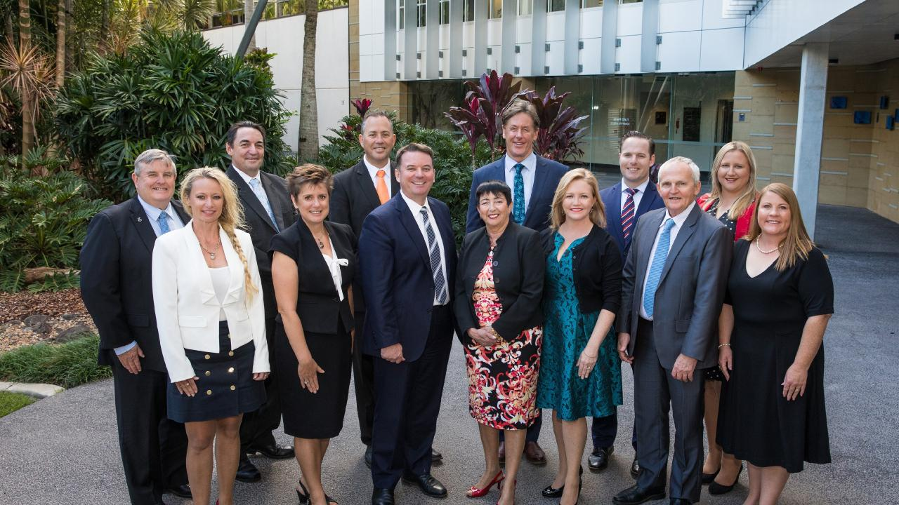 The former Logan City Council, from left, Laurie Smith, Trevina Schwarz, Phil Pidgeon, Lisa Bradley, Steve Swenson, mayor Luke Smith, deputy mayor Cherie Dalley, Darren Power, Laurie Koranski, Jon Raven, Russell Lutton, Stacey McIntosh and Jennie Breene.