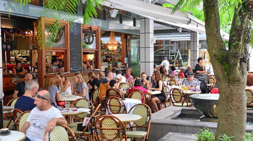Tourists enjoying the hospitality on Hastings Street, Noosa Heads. Aromas.
