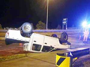Ute flipped on busy road with the driver nowhere to be seen